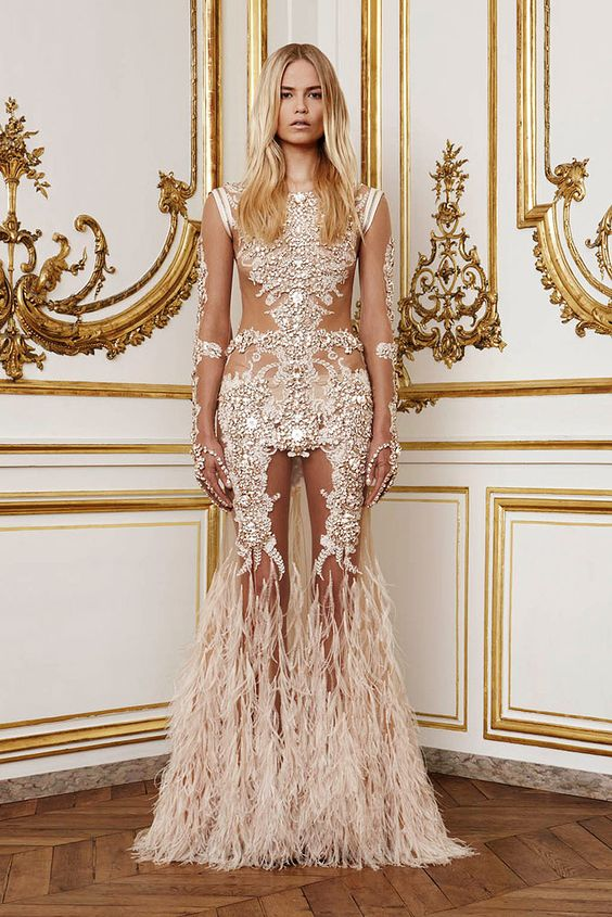 this would be an example of stretchy tulle covering the arms, with appliques. dont like how militant this is, but like the feathers and the skin showing: