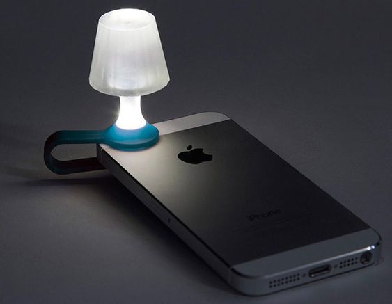 A teeny tiny lamp powered by your phone's flashlight. | 26 Ingenious Products That Will Literally Light Up Your Life