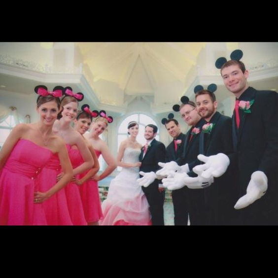 Omg. Or we could WEAR mickey mouse ears! But... no, the wedding party can! I still have my crown :D