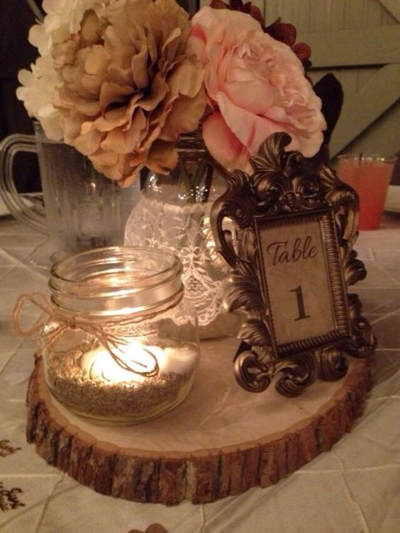 Our rustic shabby chic center pieces...instead of table numbers, put pictures of the happy couple!