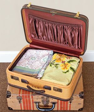 Old suitcases to store linens--perfect in a guest bedroom