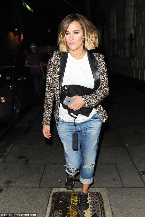 Sticking to her trademark look: Caroline Flack rocked a well put-together look of cropped boyfriend jeans and a simple t-shirt, under a leopard print blazer with black leather lapels
