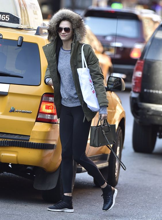 Pin for Later: 19 Reasons Karlie Kloss Is Our Street Style Icon For Life To Run Errands in a Favorite Furry Parka and Smart Satchel Karlie wearing Nike.