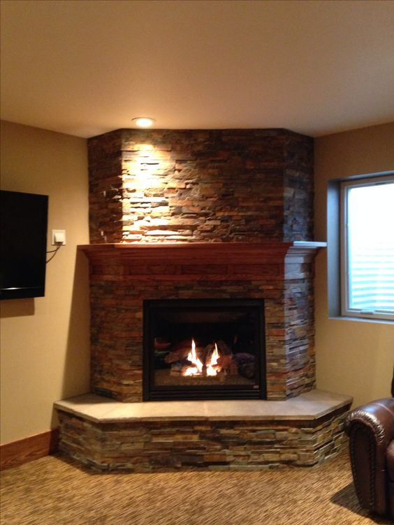 Basement fireplace- like the idea of the 3 sides to give it a bulkier look. Not a fan of the stone.