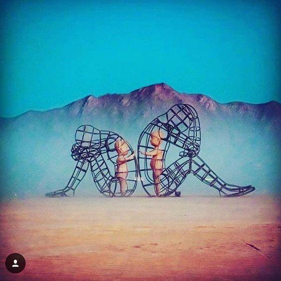 Love Alexander Milov Burning Man Nevada Image Source - Thought provoking burning man sculpture shows inner children trapped inside adult bodies