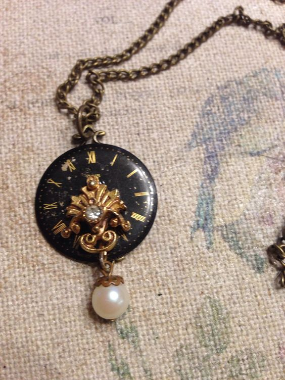Black watch face necklace by lovelostcreations on Etsy https://www.etsy.com/listing/235972070/black-watch-face-necklace