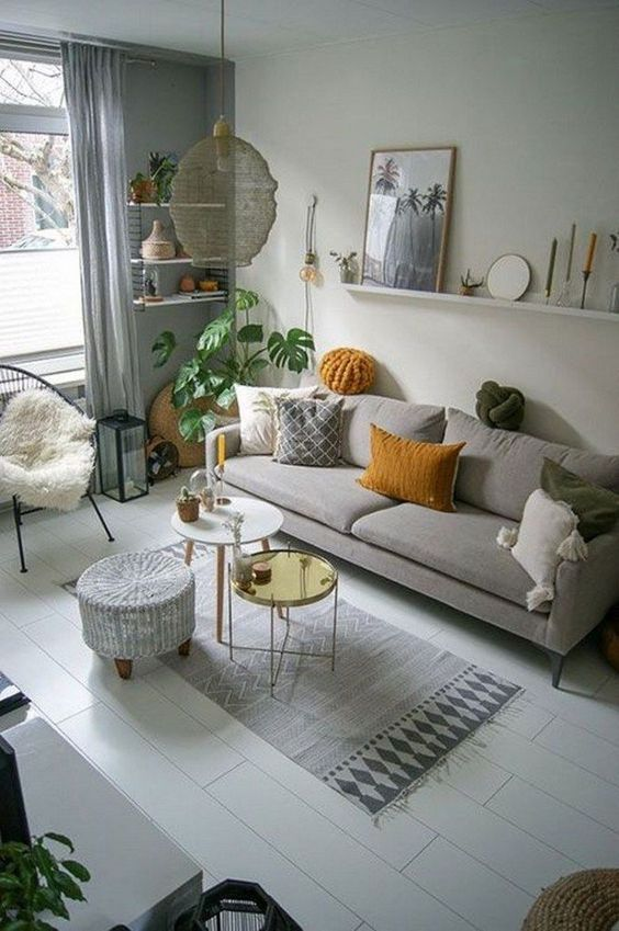 Modern Living Room Grey Couch Wall Art Plants Patterned Carpet