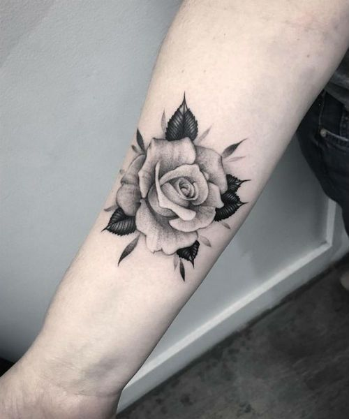 7 Of The Cool And Trendy Flower Tattoo Designs For Men And Women Styles Beat White Rose Tattoos Rose Tattoo Forearm Rose Tattoos On Wrist