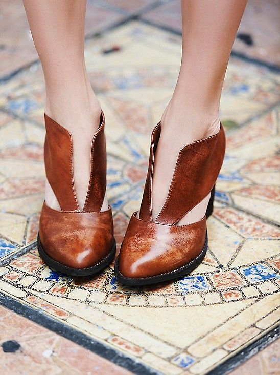 Deep v ankle boots from Free People. It looks like they have wings