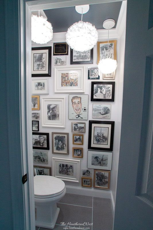 Water Closet With Large Gallery Wall In Grey Bathroom With Feather
