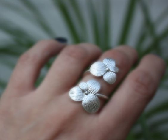 A stunning handmade sterling silver ring. The blossoms are crafted with the technique of lost wax with a texture of a real flower!  The blossoms
