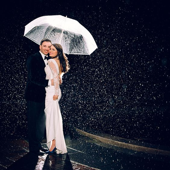 "Why We Love It: Don't let a little rain put a damper on your wedding day! We love this gorgeous photo.Why You Love It: ""I like this one"