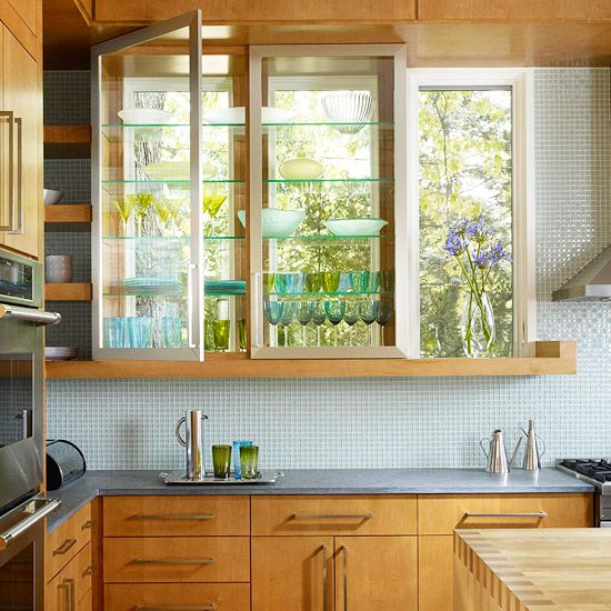 glass cabinet doors with windows at back of cabinets!