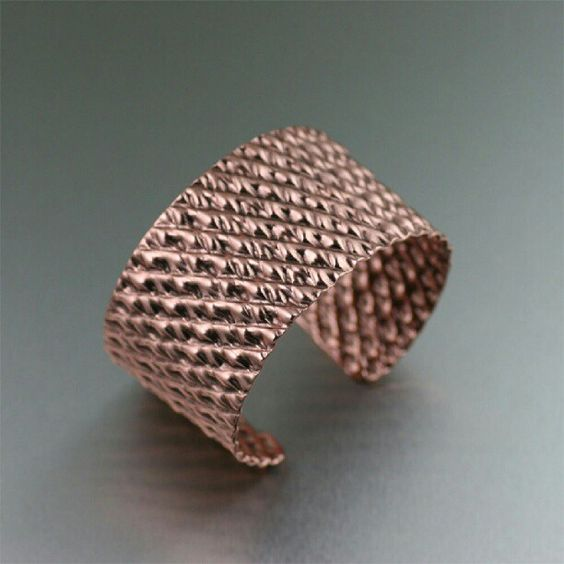 This big, bold copper beauty quickly becomes your ultimate favorite cuff. The double-corrugated motif sets this cuff apart from the rest. Wear it for fun or wear it with formal wear. Either way, you�ll love the way this copper hugs your wrist. #corrugated #copper #cuff #coppercuff #handmade #bracelet #designer