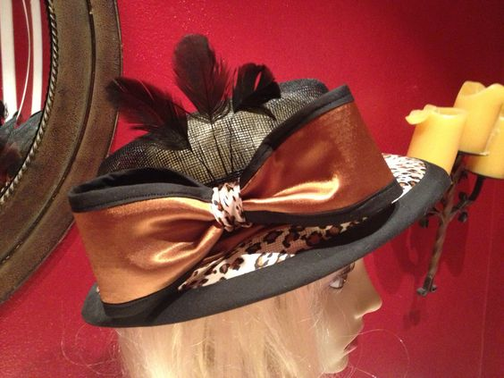 Original design hand-blocked sinamay covered in leopard charmeuse.  Trimmed with sinamay/charmeuse bow and coque feathers.