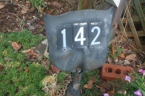 shovel repurposed as address sign: