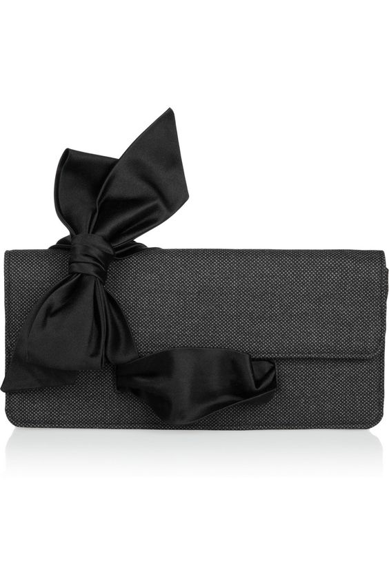 this is really cool. the lower black ribbon is a strap to wrap your hand through! christian louboutin at net-a-porter.