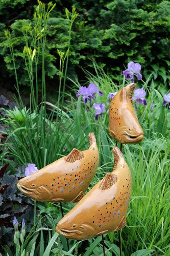 Beautiful ceramic and stainless steel sculptures by Maine artist Tyson M. Weiss that deliver a fluid aesthetic to your home and garden.: