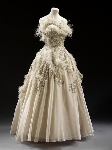 Pierre Balmain c1950-1955 |  White silk organza trimmed with sequins, rhinestones and ostrich feathers. Interior boned and supported by silk, nylon and tulle.