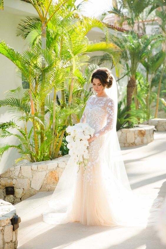 Photography: Sara Richardson Photography - sararichardsonphoto.com Floral Design: Cabo Floral Studio - cabofloralstudio.com/ Wedding Dress: Carolina Herrera - carolinaherrerabride.com/category/the-collection/   Read More on SMP: http://www.stylemepretty.com/destination-weddings/2015/11/15/paradise-found-romantic-tropical-wedding-in-mexico/