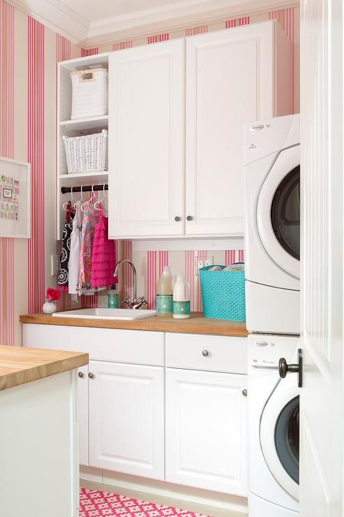 Girly White And Pink Laundry Room Is Accented With Pink Striped Wallpaper And A Pink Diamond Pattern Laundry Room Storage Laundry Room Decor Pink Laundry Rooms