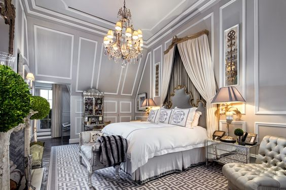 * Royal concept for master bedroom design there is beautiful light colored wall along with royal wall paneling paten  & stunning chandelier & Lamp post some green touch by small platers *
