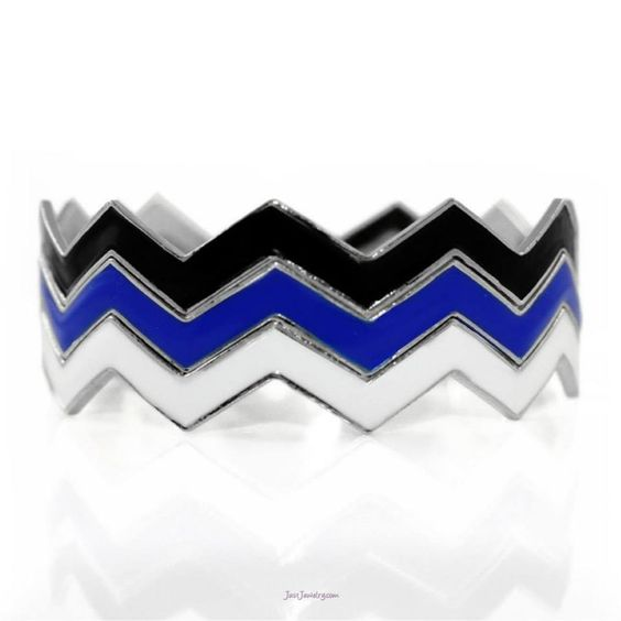 CHEVRON BRACELET  $18.00  Item # B-012454  bangle bracelet  Embrace the chevron trend with this fun and fabulous 3-row bracelet. Black, white, and cobalt blue enamel look stunning against rhodium plating