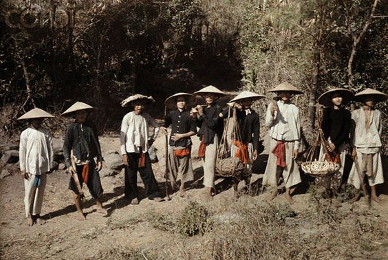 Vietnam 1931 - Vietnamese with large sunshade hats    Large sunshade hats protect these men from the tropic sun --- Image by © W. Robert Moore/National Geographic Society/Corbis