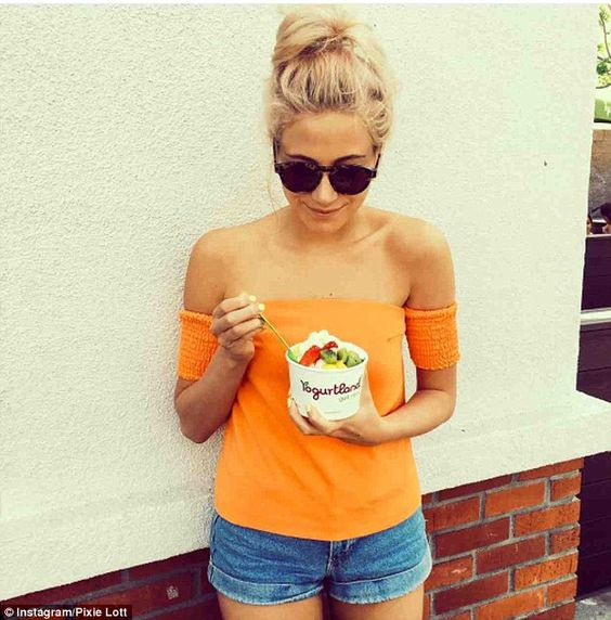 Fun in the sun:Teaming her skimpy shorts with a bright orange bardot top, the Mama Do hit...