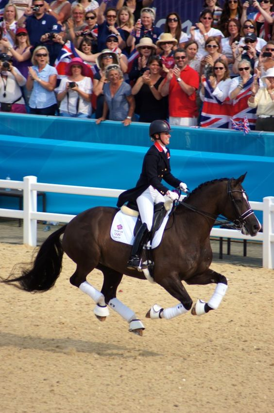 British Olympian Charlotte Dujardis and Valegro made history today by becoming Great Britain's first individual gold medalist in dressage, adding to her team gold medal... and to think, she only began riding Grand Prix in 2011!  Love this joyful photo and love that helmet on her head!    #Olympics #equestrian