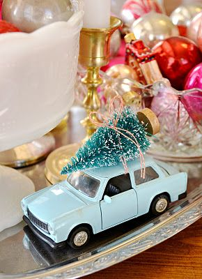 Tiny tree tied to the top of a toy car for a Christmas display