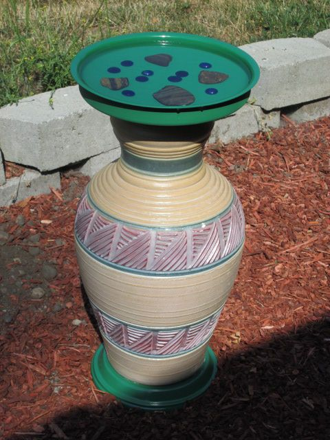 Bird bath made from and old lamp, terra cotta saucer, and an old stainlees pot lid.