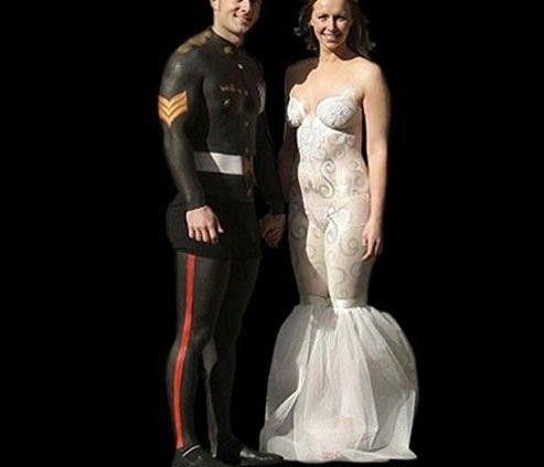 This supposed to be a photo of a Marine and his bride on their wedding day. Instead of clothing they wore body paint and I think it is distasteful. Not because they are nude but because he is painted in his uniform and it just looks bad.