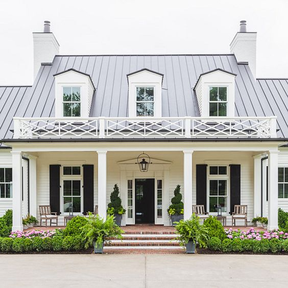 White Home Exterior painted in Sherwin Williams Greek Villa. Black Shutters and Black Front Door Paint Color is Sherwin Williams Caviar. #SherwinWilliamsGreekVilla #SherwinWilliamsCaviar Alyssa Rosenheck Photography. Castle Homes.
