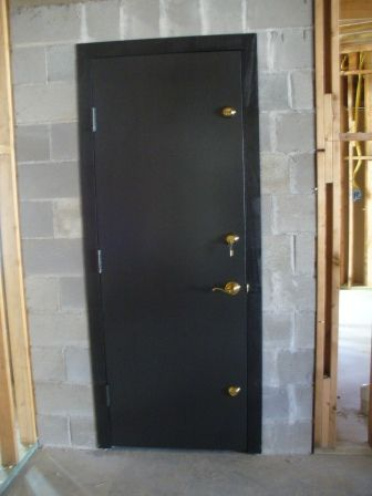 Triple deadbolts on FEMA safe room door. You must have this for hurricane and tornado protection, so worth the $ to keep your family safe!!!