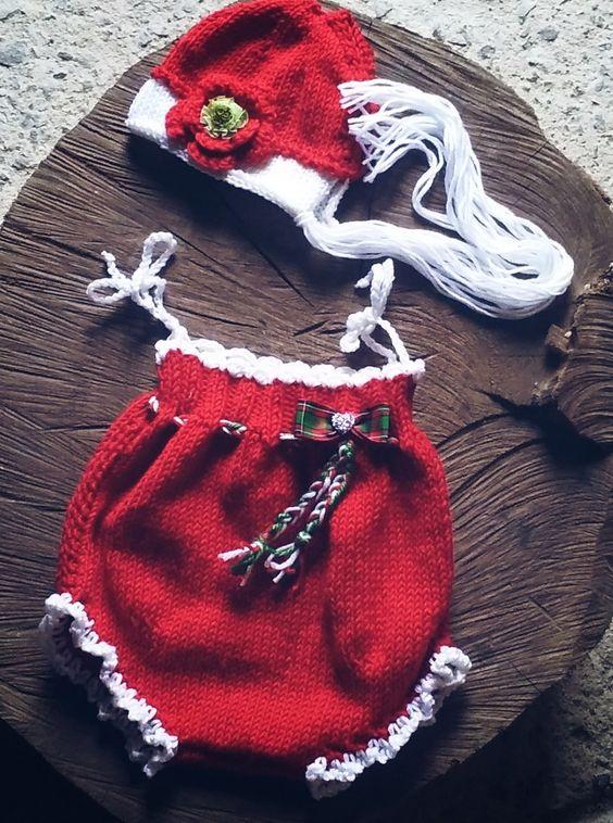 Conjunto de romper e touca confeccionados em tricô em foi 50% algodão e 50% acrílico especial ( super macio) <br>Detalhes laço, coração em Strass <br>Cor vermelho e branco <br>Tamanhos RN-1 a 3- 3 a 6 meses