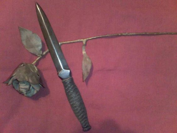 Throwing dagger and a metal rose. Made by Poisonblade Knives.