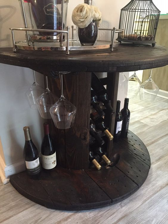 Handmade, reclaimed wooden cable spool wine bar. This one-of-a-kind wine bar is sure to stand out and would be a great conversation piece! Its been lightly sanded and brushed with a dark stain espresso to give it a rustic look. All original wood, with unique characteristics and natural imperfections that adds to the beauty, character, and charm of this piece. Just gorgeous! A great addition to any wine enthusiast home or wine cellar! ♡  DETAILS: • Holds six 750ML bottles of wine. • Wine…