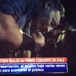 Bruce Springsteen - Kissing a fan in Chile, after Rock in Rio, 2013
