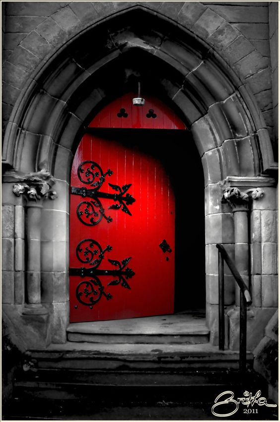 Dramatic Red Door Trimmed In Black Scroll Work Rivets The Eye With Its Soaring Gothic Arch Beautiful Finishing Touch On This Majestic Building