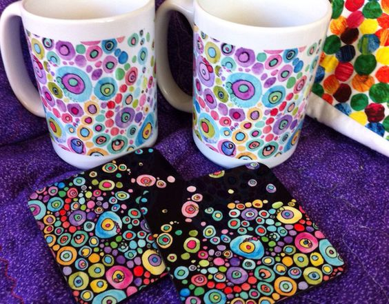Coaster and mugs by Catherine Holcombe at deviant art