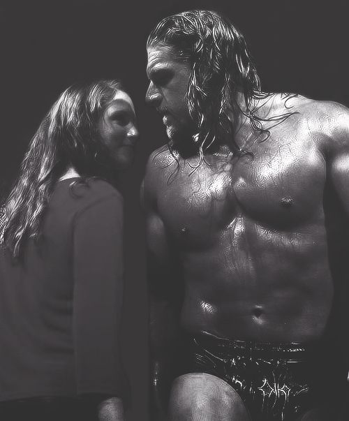 Love this photo of husband and wife! Triple H & Stephanie McMahon.