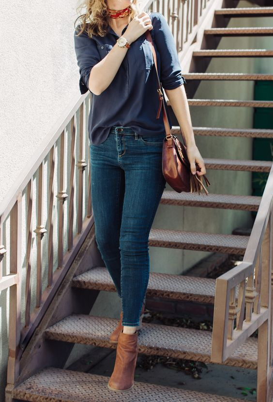 navy blue blouse, denim skinny jeans and brown leather accessories