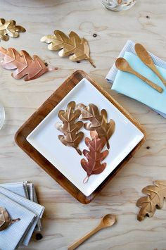 Metallic Leaves Table Decor made from a foil baking sheet.  How clever! | Oh Happy Day!