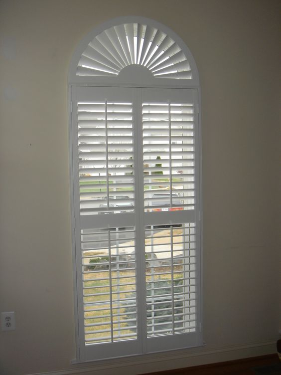 2 1 2 Interior Shutters With A Sunburst Shutters By The Louver Shop Arched Plantation