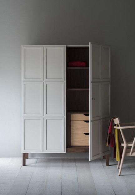 The Frey Armoire features paneled doors, which open to reveal timber-lined interiors. We offer a series of standard internal configurations.