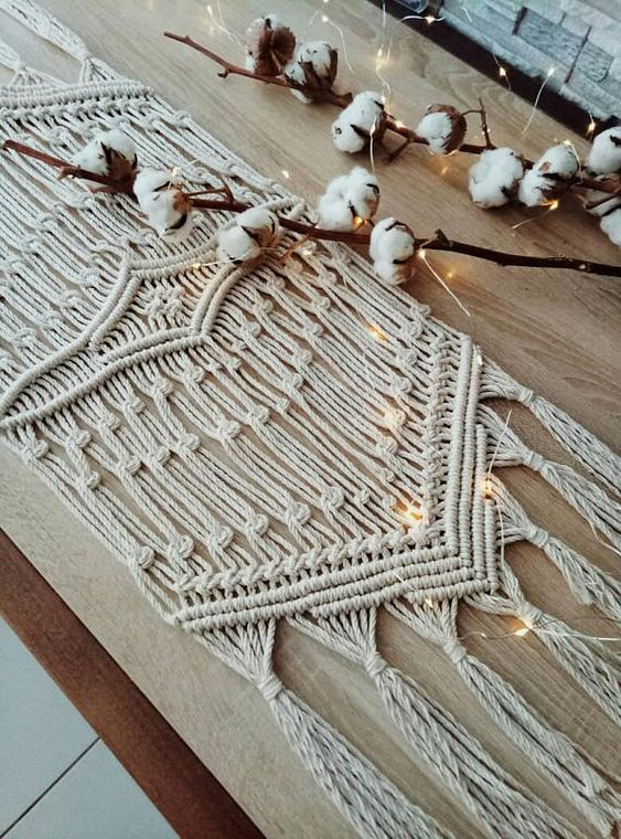 Macrame table runner made of unbleached cotton rope. Beautiful bohemian home decoration. It helps you to create the Hygge look at home! Dimensions: width - 32 cm / 13 length - 130 cm / 52 betwen the longest points of fringe. Color: Ivory, but very light (unpainted cotton). Very close