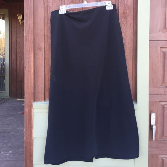 Black maxi skirt. 92% polyester 8% spandex Black maxi skirt, flattering cut easy wash. EUC. 2X Ms Planet Skirts Maxi