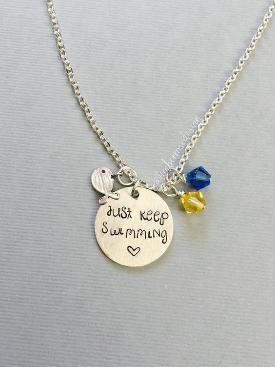What do we do, swim, swim, swim.  This necklace is inspired by Disney Pixars Finding Nemo. Featuring the words, Just keep swimming. It is