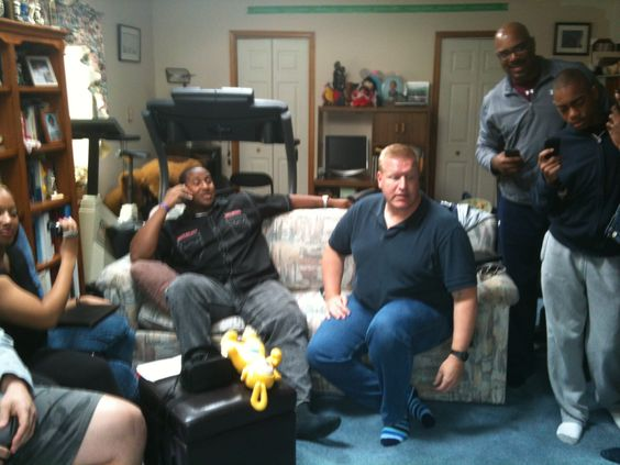 Mike Daniels at his Draft Day Party. He is on the phone with Coach Mike McCarthy of the Green Bay Packers